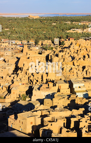 Ruins of Shali citadel with temple of the Oracle in background. Siwa oasis, Egypt - Stock Photo