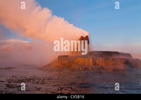 Fly Geyser with snow capped Granite Range in the Black Rock Desert near Gerlach, Nevada, USA - Stock Photo