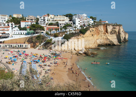ALGARVE, PORTUGAL. A view of the beach and town at the holiday resort of Praia do Carvoeiro. 2012. - Stock Photo