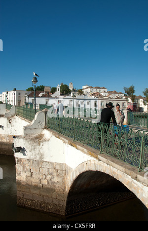 ALGARVE, PORTUGAL. The Ponte Romana (Roman bridge) over the Rio Gilao in the historic town of Tavira. 2012. - Stock Photo