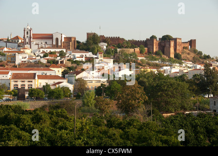 ALGARVE, PORTUGAL. An early-morning view of Silves, with the cathedral and castle dominating the skyline. 2012. - Stock Photo