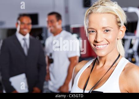 pretty female gym trainer closeup portrait - Stock Photo
