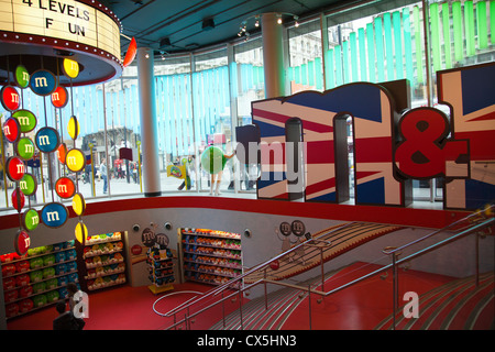 M&M World in Leicester Square at Swiss Court Building - London UK - Stock Photo