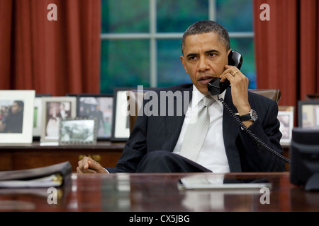 US President Barack Obama talks on the phone April 28, 2011 with Homeland Security Secretary Janet Napolitano and - Stock Photo