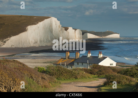 Coastguard Cottages and Seven Sisters cliffs, East Sussex, England. - Stock Photo