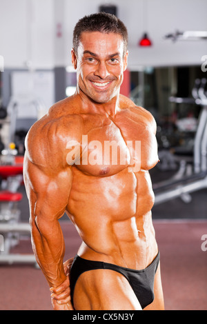 Middle Aged Caucasian Body Builder Man Flexing Muscles
