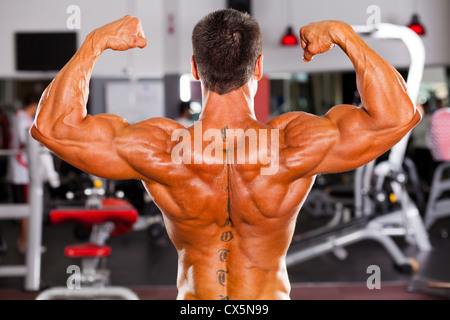 rear view of male bodybuilder - Stock Photo