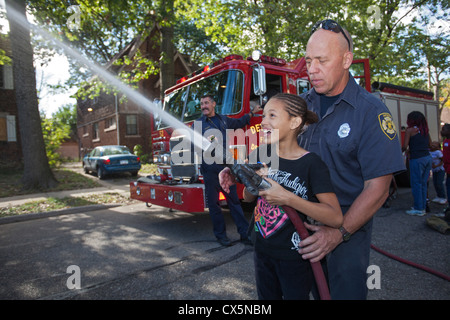 Fire Fighters with Children at a Detroit Block Party - Stock Photo