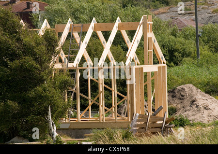 timber house houses home homes frame framed wood wooden under construction building buildings sweden swedish pine - Stock Photo