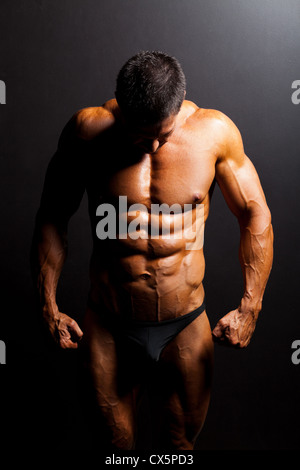 muscular man's body in studio light - Stock Photo