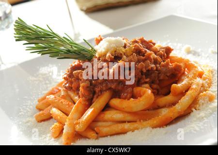 italian maccheroni with Bolognese sauce - Stock Photo
