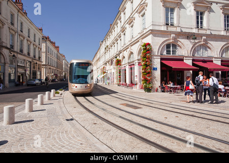 A tram goes down rue Jeanne d'Arc in orleans, France. - Stock Photo