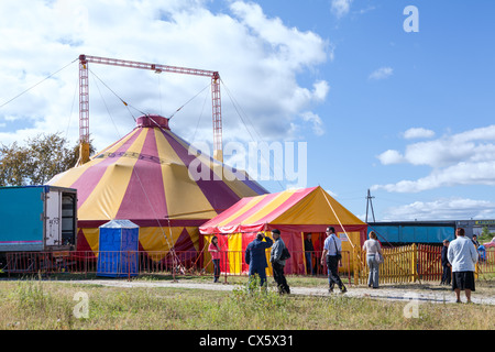 People Coming Out Of The Traveling Circus Big Top In