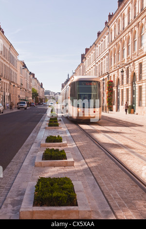 A tram goes down rue Jeanne d'Arc in Orleans, France - Stock Photo