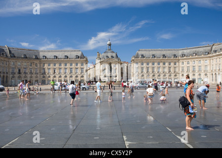 Place de la Bourse and the Miroir d'eau, Bordeaux, France - Stock Photo