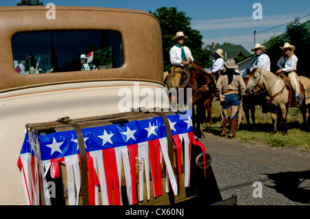 Vintage automobile in Chief Joseph Days parade on Main Street in small town of Joseph, Wallowa County, Oregon, USA - Stock Photo