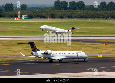 Ground handling of air planes at Düsseldorf International Airport. Germany, Europe. - Stock Photo