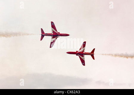RAF Red Arrows display team synchronised pair perform close pass at Best of British Show Cotswold (Kemble EGBP) - Stock Photo