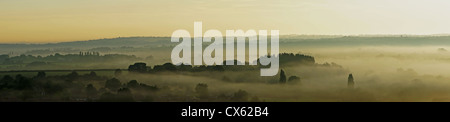A misty sunrise in the south downs overlooking Houghton and towards Amberley. - Stock Photo