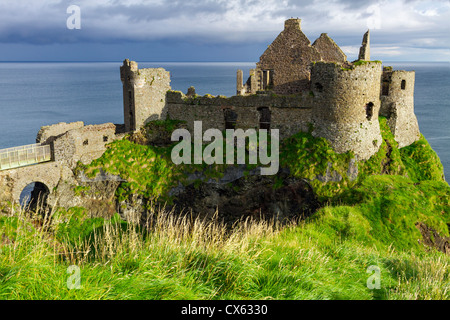 Dunluce Castle is a now-ruined medieval castle in Northern Ireland. It is located on the edge of a basalt outcropping - Stock Photo
