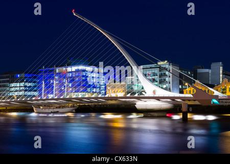 Dublin, Ireland - August 21st, 2012: view of Samuel Beckett bridge over river Liffey being open during Tall Bridge - Stock Photo
