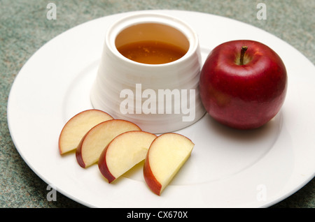 Traditional Jewish food, apple and honey for the holiday of Rosh Hashana (Jewish New Year). - Stock Photo