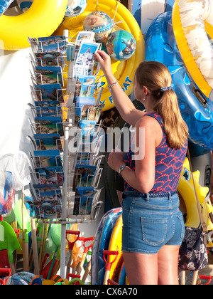 ALGARVE, PORTUGAL. A woman buying postcards. 2012. - Stock Photo