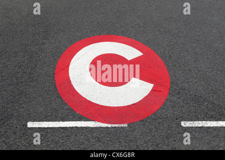 Congestion charge sign on the road, London, UK - Stock Photo