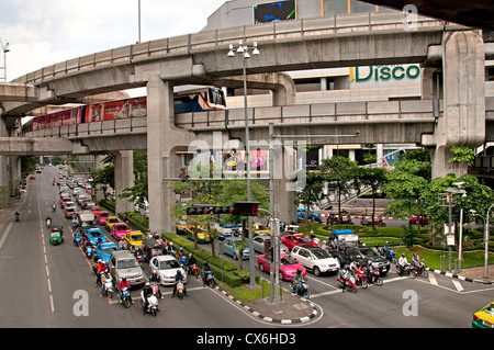Skytrain crosses Pathumwan Siam Square district Center Bangkok Thailand Thai - Stock Photo