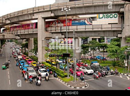 Skytrain crosses Pathumwan Siam Square district Center Bangkok Thailand Thai - Stock Photo
