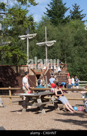 children playing on pirate ship in childrens playground - Stock Photo