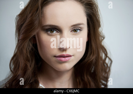 A young brunette woman looking to camera - Stock Photo