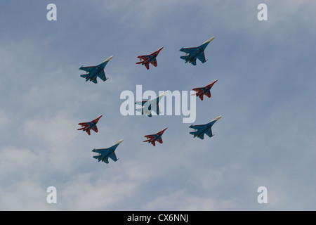 Russian fighter planes Su-27 and MiG-29 performing over Red Square during Victory Day parade - Stock Photo