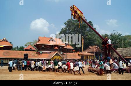 Garudan Thookkam Temples ritual (Kite Swinging or Eagle Hanging) in Chirayinkeezhu Sri Sarkara Devi Temple at Kerala - Stock Photo