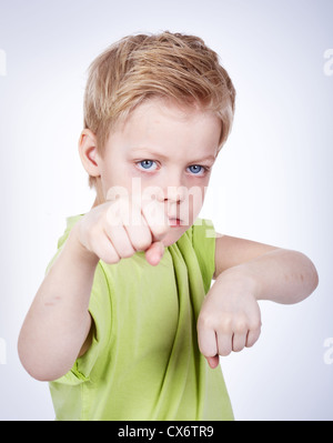 Cute little boy ready to fight someone - Stock Photo