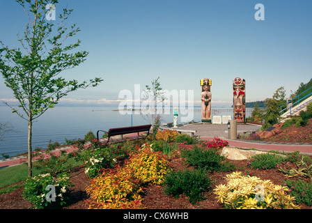 White Rock, BC, British Columbia, Canada - Seaside Promenade Walkway and Coast Salish and Haida Totem Poles along - Stock Photo
