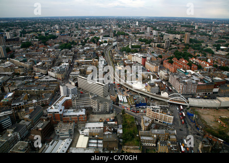 Aerial view of Great Eastern Road and the Overground railway cutting their way through Shoreditch and Hoxton, London, - Stock Photo