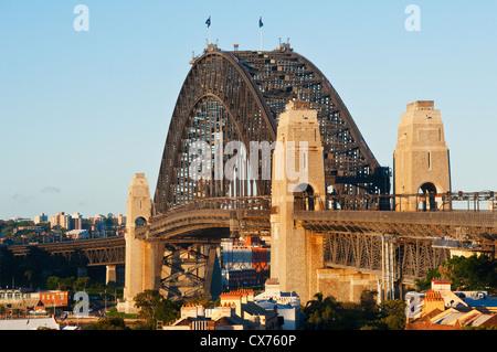 Famous Sydney Harbour Bridge in evening light. - Stock Photo