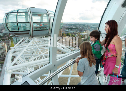 Mother and children enjoying the view from the London Eye - Stock Photo