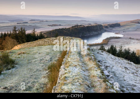 Hadrian's Wall at Hotbank Crags looking towards Crag Lough in Northumberland National Park, England - Stock Photo