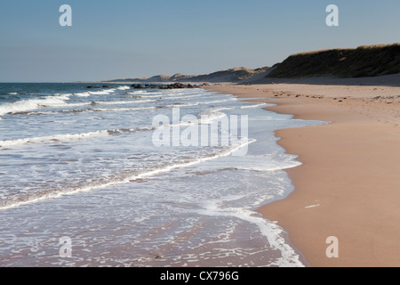 An empty sandy beach at Scremeston on the Northumberland coast of England - Stock Photo