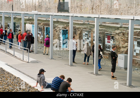 Tourists at the Topography of Terror outdoor museum in Berlin, Germany, which includes a preserved section of the - Stock Photo
