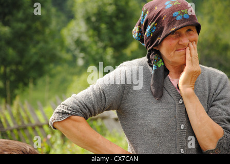 Peasant woman in the Carpathian mountain region of Maramures, Romania - Stock Photo