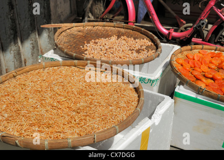 Dried fish for sale at an outdoor market in Tai O Lantau Island China. - Stock Photo