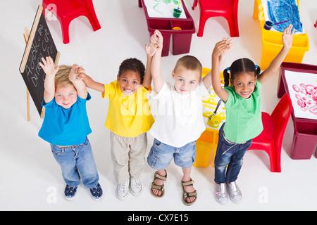 young preschool children in classroom - Stock Photo