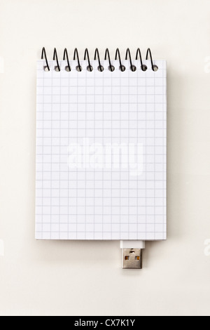 A spiral notepad with USB connector imitating a USB stick - Stock Photo