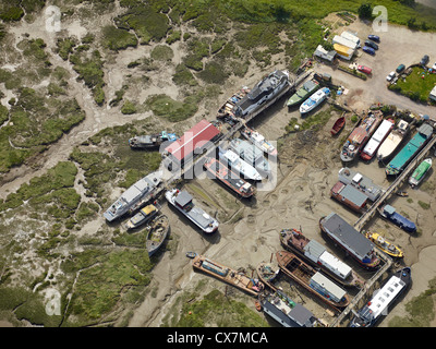 House boats at low tide on the  river Medway, Strood, Chatham, Kent, south east England - Stock Photo