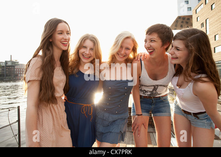 Five young women standing on a jetty next to the Spree River, Berlin, Germany - Stock Photo