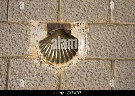 A brass scallop shell along the route of the camino to Santiago de Compostela, Spain. - Stock Photo
