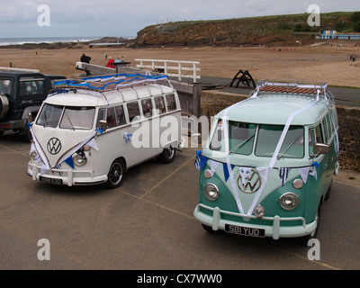 Two VW campervans being used as wedding cars, Cornwall, UK - Stock Photo